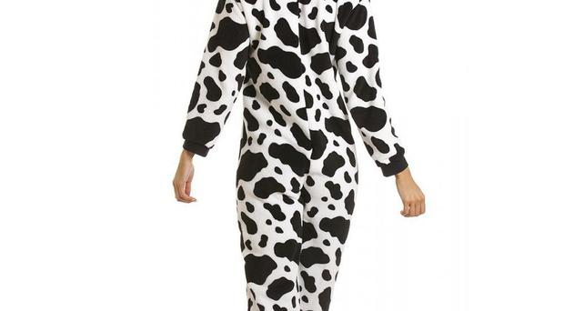 A man was robbed in Belfast's Great Victoria Street by a woman wearing a cow print onesie
