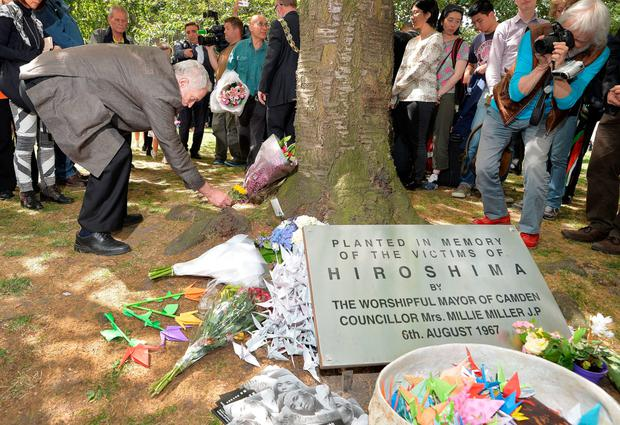 Jeremy Corbyn lays flowers during an event to mark the 70th anniversary of the Hiroshima bomb, in Tavistock Square, London