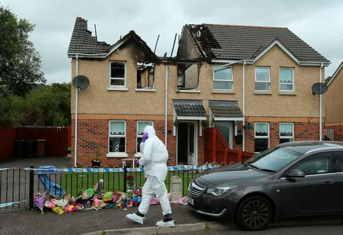 A police forensics officer at the scene in Lagmore, Belfast, where the 30-year-old was found dead
