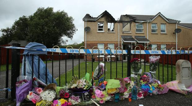 Flowers at the scene of the house fire where Jennifer Dornan was found dead
