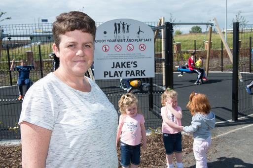 Jakes's mum Leona outside the new play park named after her son in Racecourse Park, Londonderry