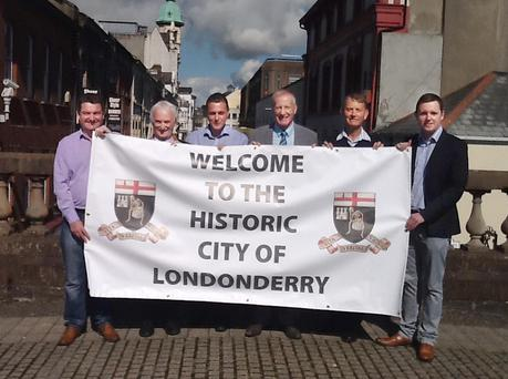 DUP MP Gregory Campbell (third from right) with councillors David Ramsey, Drew Thompson, Graham Warke and Maurice Devenney, and Gary Middleton MLA, holding the banner to be erected for the Apprentice Boys parade in the city