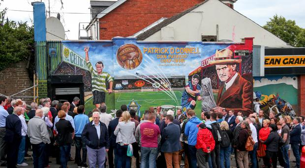 Politicians including Gerry Adams and Arder Carson joined the family of Patrick O'Connell as his mural on the Whiterock Road in west Belfast was unveiled yesterday
