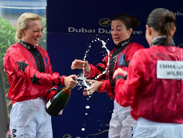 Sammy Jo Bell sprays champagne over Hayley Turner and Emma-Jayne Wilson after their win in the Shergar Cup
