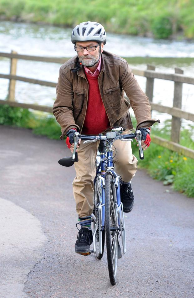 Writer and academic Malachi O'Doherty out and about on his bike in Belfast