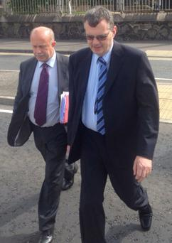 Trevor Fleming (right) and solicitor Tony Caher leaving Antrim court on an earlier occasion