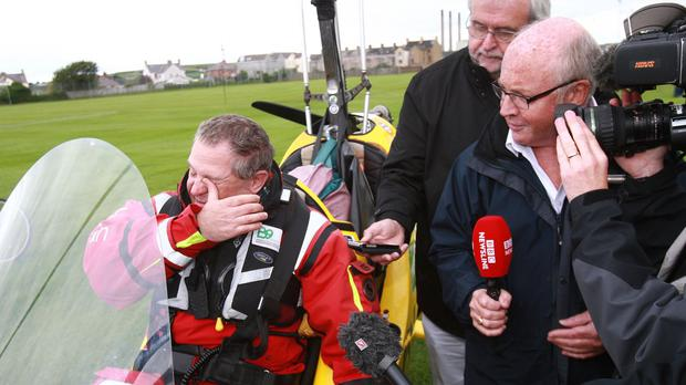Northern Ireland adventurer Norman Surplus has completed a record flight around the world in a gyrocopter
