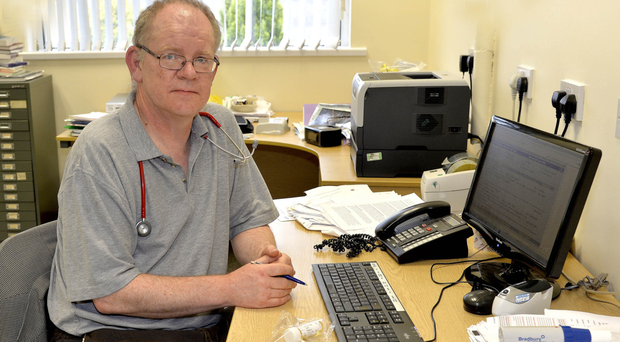 Dr Patrick Fee, who considered resigning over staff shortages, at work in his Crossmaglen surgery