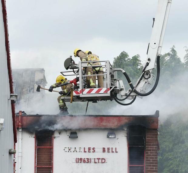 Northern Ireland Fire and Rescue Service at the scene of a fire at an old factory site on the Oldpark Road in north Belfast yesterday