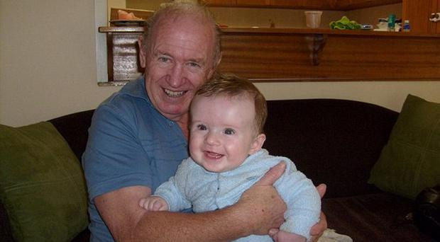 Michael with one of his grandsons