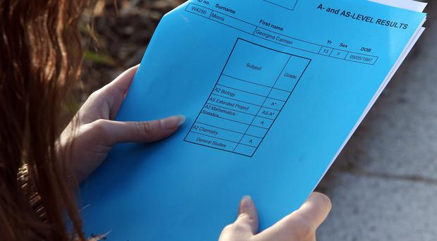 Many students opted for the old fashioned method of opening brown envelopes alongside friends rather than accessing their results online