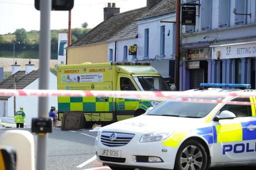 Police and an ambulance at the scene of the fatal accident in Ballynahinch yesterday