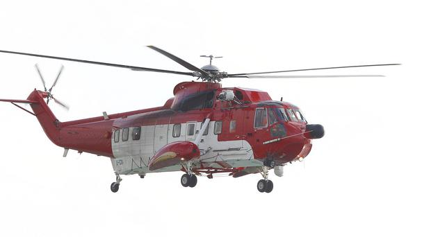 An Irish Coastguard helicopter joined the search after a crashed car was found empty