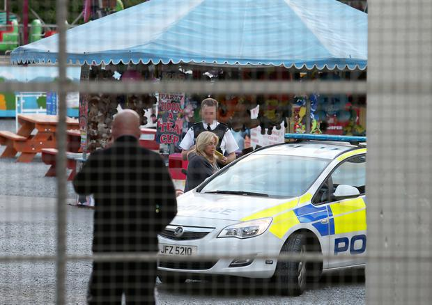 Police officers at the amusement park in Newcastle where young Bradley Logan collapsed and later died on Friday