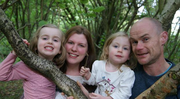 Mark Tohill with wife Stephanie and daughters Grace and Orlaith