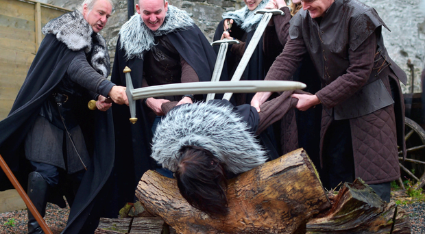 Lead Game of Thrones tour instructor William Kells 'beheads' a tourist as part of the Winterfell Experience at Castle Ward