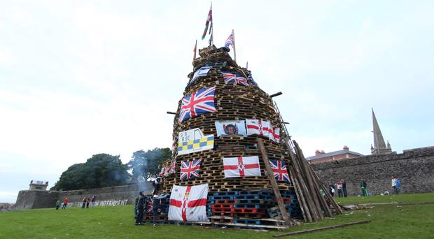 A nationalist bonfire close to Derry's walls, including unionist flags and effigies of soldiers, which was burned at the weekend