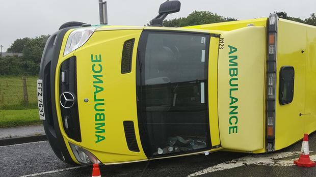 An ambulance is seen lying on its side after it collided with a car close to Portrush (NIAS/PA)