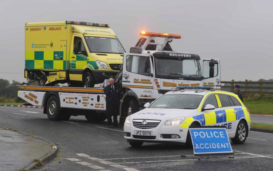 An ambulance is removed by a recovery vehicle after a collision with a van at Atlantic Road, Portrush, yesterday