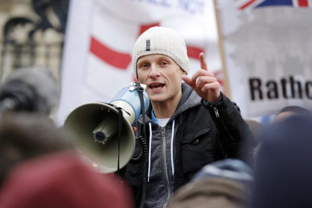 Bryson addressing a demonstration in Belfast city centre in 2013