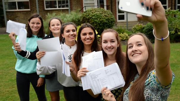 Twins Martha and Clara Finn, Lydia and Eleanor Tsoukkas and Phoebe and Rosanna Codrington take a selfie while they hold their GCSE results at Putney High School in west London