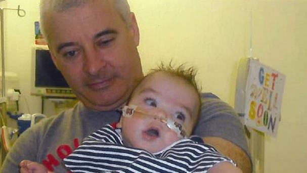 Kevin McGuigan with his grandson Ollie, who was in hospital in 2011 (PSNI/PA)