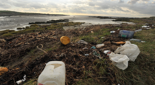Litter and plastic strewn across the beach at St John's Point in Co Down