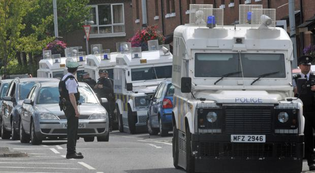 Police, fearing possible reprisal attacks from feuding republicans, maintained a heavy presence around the vicinity of Short Strand during the funeral of Kevin McGuigan on Tuesday