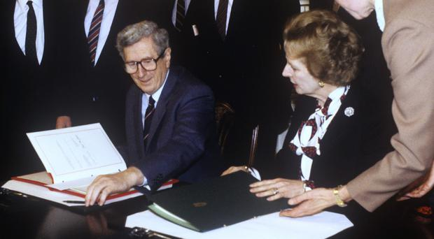 Prime Minister Margaret Thatcher and Taoiseach Dr Garret FitzGerald prepare to sign the Anglo-Irish Agreement at Hillsborough Castle, Northern Ireland, in 1985