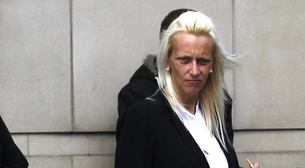 Carly Harris leaves Belfast Coroner's Court following the inquest of her husband Rifleman Dale Harris and Lance Corporal David Gwilt