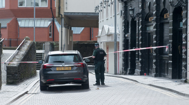 A police officer in Bank Place, Derry, yesterday where an investigation is under way into the death of 25-year-old Conall Kerrigan on Sunday night