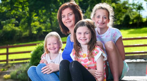 Sinead Scullion at her home in Moneymore with her children Chloe, Hannah and Ciara