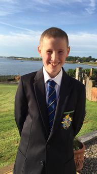 A smiling Joshua in his Bangor Grammar uniform in a picture released on social media