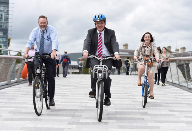 Regional Development Minister Danny Kennedy with Andrew Grieve (left) and Orla Campbell from the DRD cycling unit