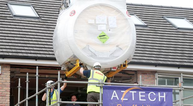 The new two tonne MRI scanner is lowered by crane into the extension of the Kingsbridge private hospital in Belfast