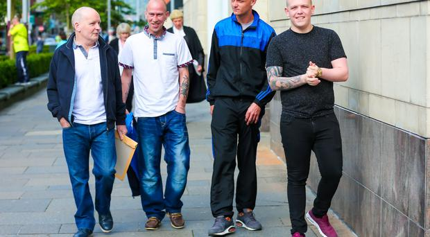 Pride of Ardoyne Flute band members Robert Hayes Spence, David John Murphy, James Cosby and Gary Edwin Wells arrive at Belfast Magistrates court yesterday