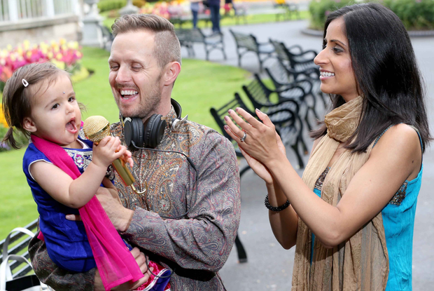 Trying out some Little Bollywood moves are Sonia and Darren McCourt and their 14-month-old daughter Amelia