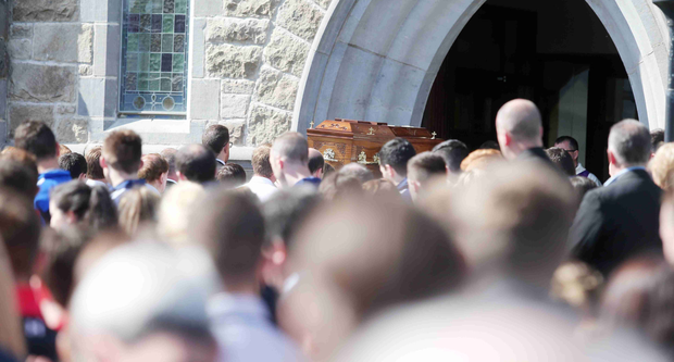 Peter Hughes' coffin is carried into St Patrick's Church in Dromintee, Co Armagh, during his funeral yesterday