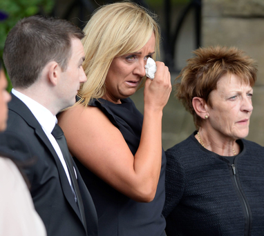 Tracey Neville and her mother Jill Neville arrive at Bury Parish Church in Greater Manchester for the funeral of Neville Neville yesterday