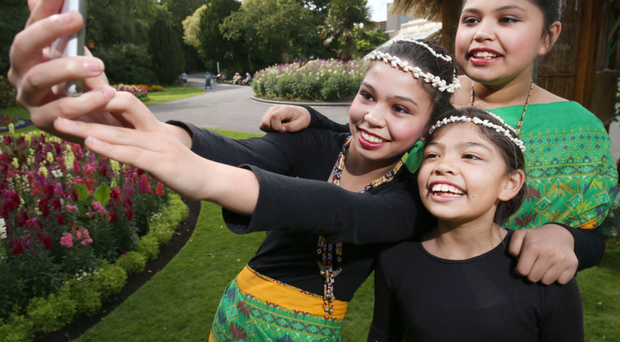 Kasey, Kirsten and Kathryn Leitch, members of Northern Ireland's Filipino community, help launch the Belfast Mela