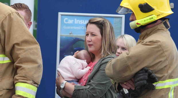 A mother was reunited with her baby yesterday after the child became locked in her car