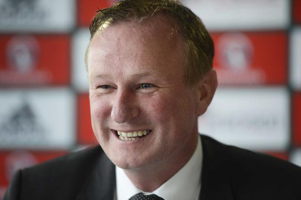 On the ball: Northern Ireland manager Michael O'Neill is in a positive frame of mind over his team's chances of qualifying for the upcoming European Championships