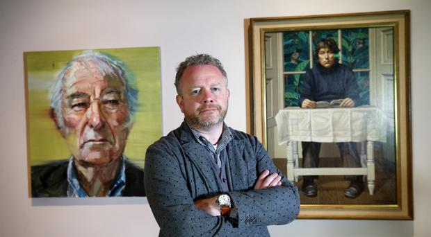 Artist Colin Davidson with the first commissioned portrait of Seamus Heaney and the last portrait ever to be painted of the celebrated poet and writer