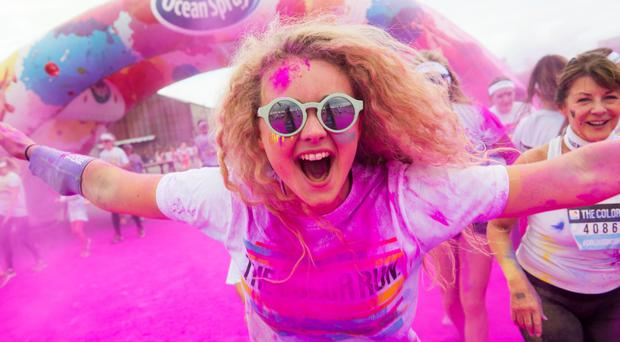 Excited crowds and competitors enjoying the kaleidoscopic Colour Run, dubbed the 'happiest 5k on the planet', at the Titanic Quarter in Belfast yesterday