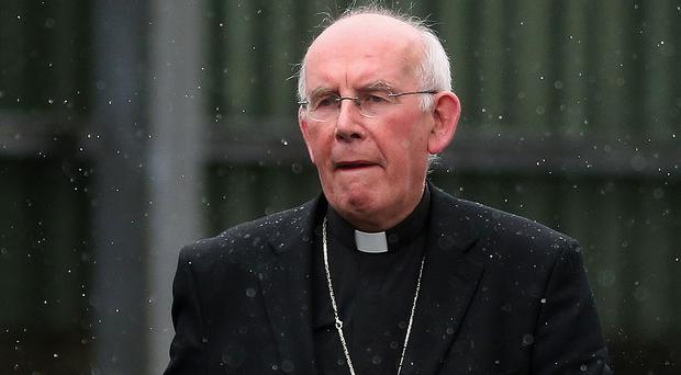 Cardinal Sean Brady leaves after giving evidence to the Historical Institutional Abuse inquiry at Banbridge Courthouse, County Down
