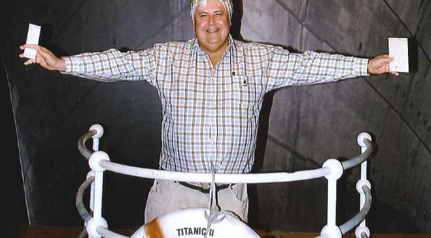 Australian billionaire Clive Palmer poses in front of an artist's impression of the Titanic ll at MGM Studios in Los Angeles