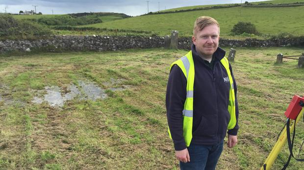 Department of Environment archaeologist Andrew Gault at a large unmarked plot in St Cuthbert's graveyard near Portrush, where it is suspected hundreds of Spanish sailors who drowned with the Armada are buried