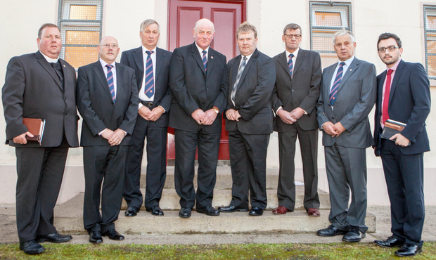 From left: Rev Nigel Reid, John Henry, Archie Reaney, Orange Grand Master Edward Stevenson, Deputy Grand Master Harold Henning, William Reaney, Berry Reaney and Stephen Kennedy at last night's memorial service to mark the 40th anniversary of the Tullyvallen massacre