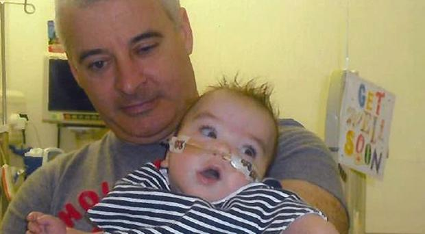 Kevin McGuigan with his grandson Ollie. Police believe his killing was a revenge attack (Family handout/PSNI/PA)