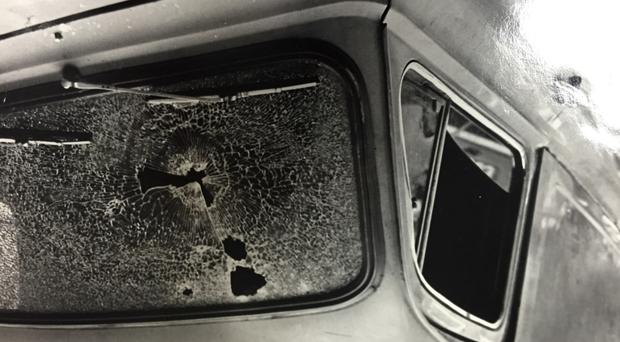 The bullet-riddled car in which Henry Thornton was killed